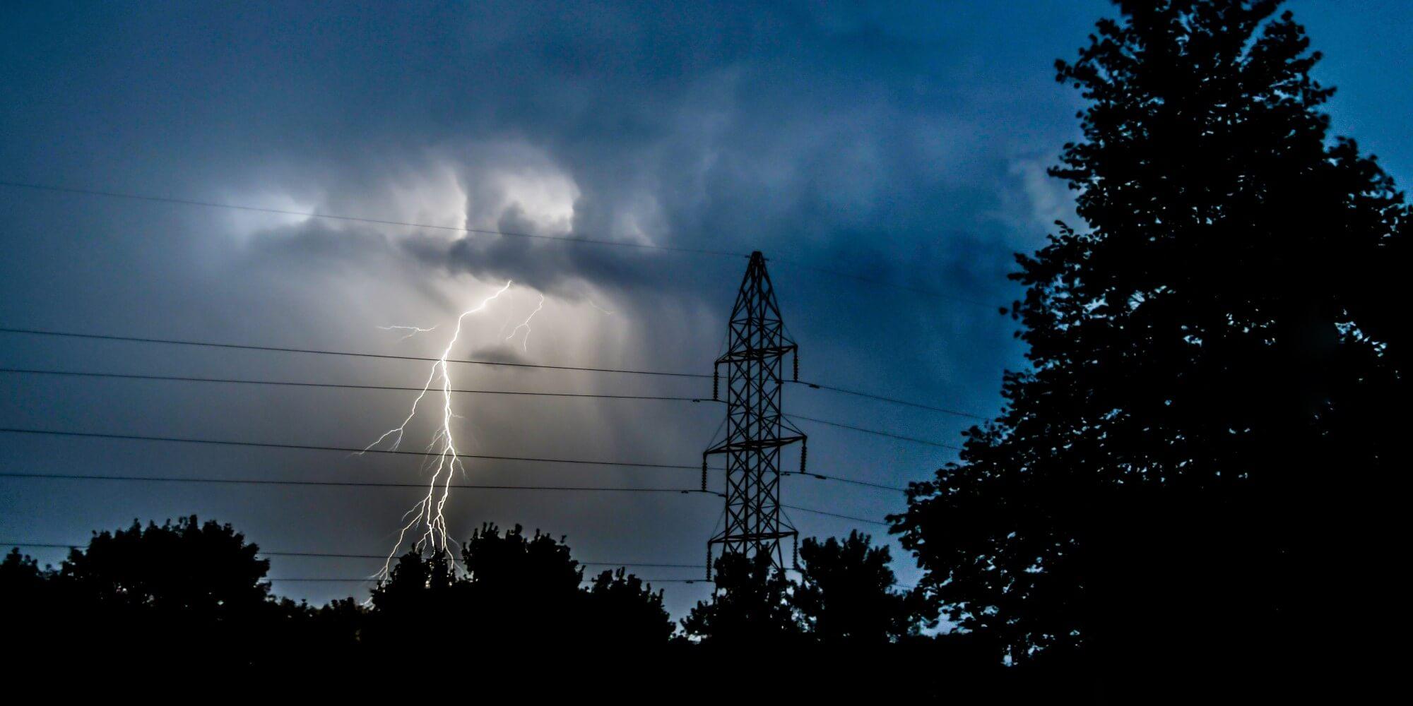 lightning bolt next to power lines